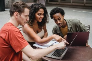 A group of three students study for an exam.